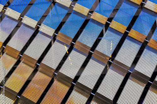 Fotografia, Obraz  Modern building facade with perforated metal plates texture.