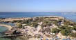 Aerial shot of the seashore and the beach at a holiday resort. Makronissos beach, Ayia Napa, Cyprus.
