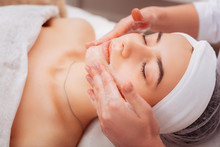 Pleasant Young Woman Having A Foam Face Massage