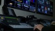 Broadcast Technician Operates Video Switcher on Live News Coverage