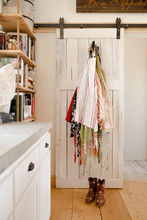 Aprons Hanging In A Country Ki...