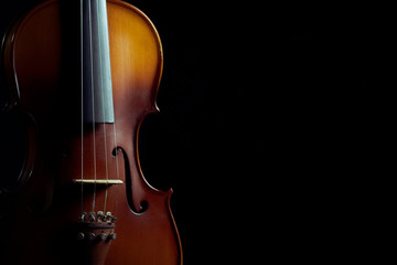 Close up violin on black background