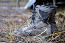 Black Shoes Of Soldiers Stained With Mud