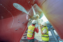 Port Controller, Surveyor, Inspector Under Inspect To Recondition, Repairing, Patnting Overhaul Of The Commercial Ship, Rudder And Propeller Fixed In Properly Assemble Installation