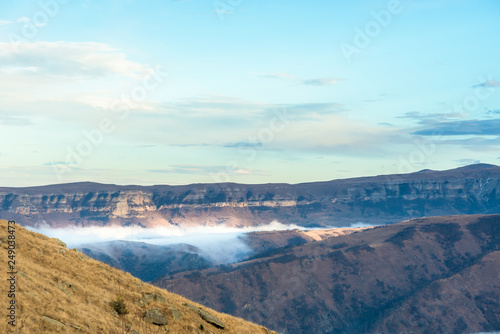 Stickers pour porte Pierre, Sable mountains in clouds. the cloud between the peaks of the mountains. Caucasian mountain area. panoramic view
