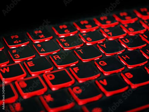 Close up. Red backlight, backlit on laptop or keyboard