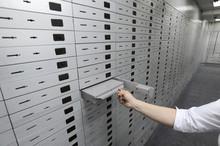A Banker Opens Safe Deposit Bo...