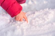 Children's Hand On The Snow