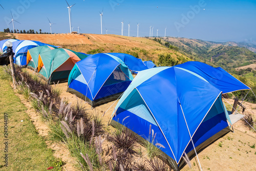 Fotografia  Tent on a grass under white clouds and blue sky.Thailand.