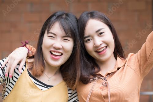 Fotografie, Obraz  Happy smiling Asian woman friend; portrait of joyful, happy, smiling asian femal
