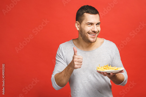 This man adores junk food Wallpaper Mural