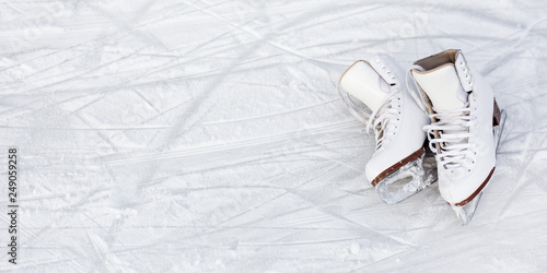 Fotografie, Obraz close up of figure skates and copy space over ice background with marks from ska