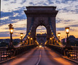 Illuminated bridge and the road on the chain bridge in the morning in Budapest