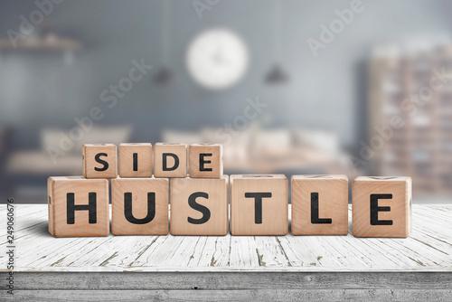 Valokuva  Side hustle sign on a plank table
