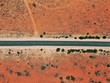 canvas print picture - Rare paved road in the australian outback near Ayers Rock / Uluru