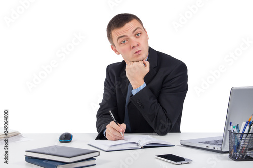 Fotografie, Obraz  Serious businessman skeptically looking at you sitting at his desk isolated on white background