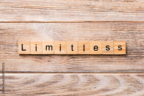 Limitless word written on wood block. Limitless text on wooden table for your desing, concept