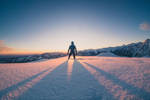 Man Running On The Snow At The Top Of A Mountain