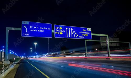 Foto op Aluminium Nacht snelweg Motorway Signs on Highway at night