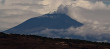 Mount Etna With Clouds And Degassing