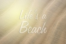 Full Frame Image Of A Beach Sand With LIFE'S A BEACH Word. Concept Of Holiday, Travel And Wanderlust