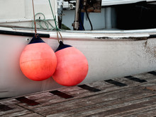 Two Buoys Hanging On Side Of F...