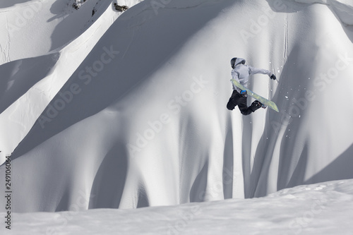 Fotografie, Obraz  Snowboarder flying on the background of snowy slope