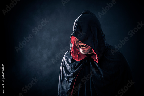 Angry vampire with red cape showing his scary teeth Fotobehang