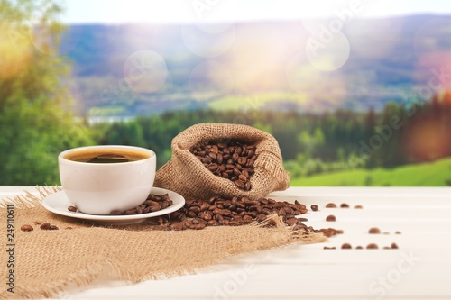 Cup of hot coffee with beans