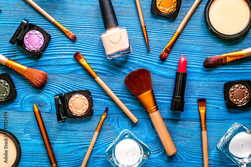 Obraz na plátně  set of decorative cosmetics on blue table background top view