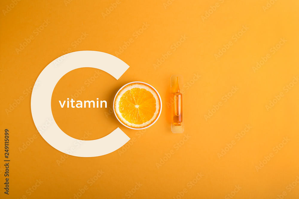 Fototapeta Serum and cosmetics with vitamin C.  Immunity protection concept, antiviral prevention Essential oil from citrus fruits.