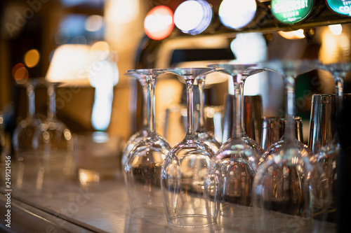 Obraz Empty Wine Glasses on a Bar Counter - fototapety do salonu