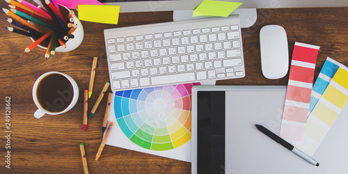 Fotografie, Tablou Modern office workplace with digital tablet, notepad, colorful pencils, glasses,