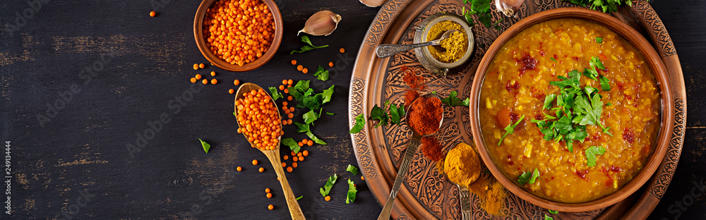 Fototapety, obrazy: Indian dal. Food. Traditional Indian soup lentils.  Indian Dhal spicy curry in bowl, spices, herbs, rustic black wooden background. Top view. Authentic Indian dish. Banner. Flat lay