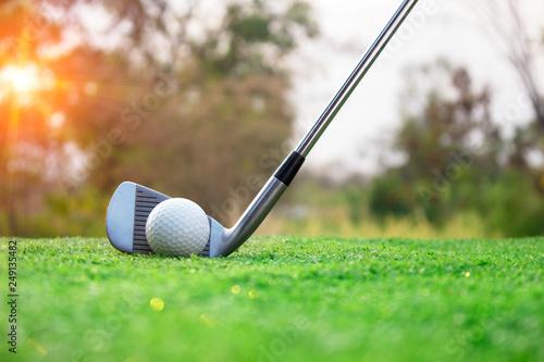 Deurstickers Golf Golf clubs and golf balls on a green lawn