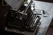 Workplace of an old school writer with mobile phone headphones and a typewriter