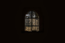 Abandoned Old Arch Window Inside Surrounded By Deep Black Darkness, Mystic Concept Photography Wallpaper Background Pattern With Empty Copy Space For Your Text Or Inscription