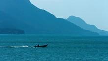 Small Motorized Fishing Boat On A Choppy Tropical Sea