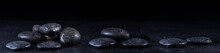 Panoramic Image Of Zen Stones With Water Drops On A Black Background