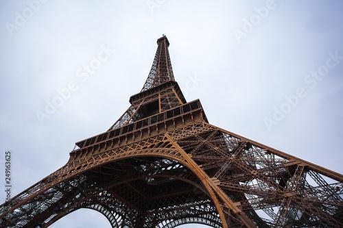 Fototapeta The Eiffel Tower in Paris shot against the sky obraz na płótnie