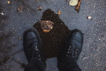 Black Boots In A Puddle