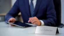 Tax Collector In Suit Using Ta...