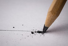 Close Up Of Broken Pencil With Drawing Line On Textured White Paper