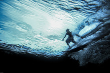Underwater View Of Surfer Riding Wave