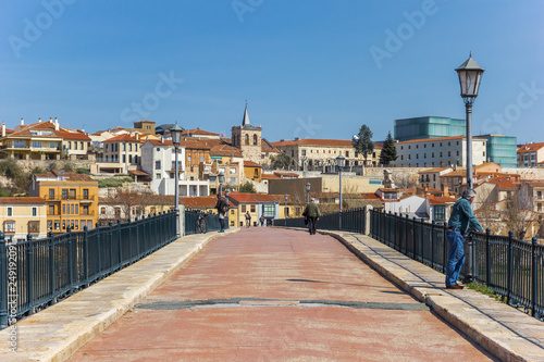 People on the historic bridge of Zamora, Spain