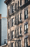New York old building with fire escapes, color toned picture, USA. - 249192290