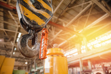 Crane Chain And Hook Blurred Warehouse Background With Remote Control. Concept Production Steel Factory