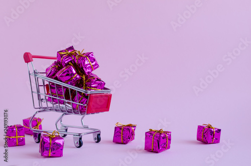 Photo  Small shopping cart with presents