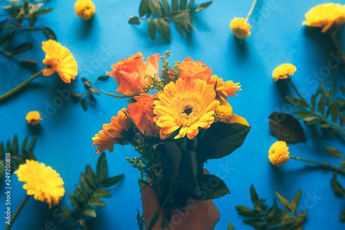 Deurstickers Waterlelies Bouquet of yellow flowers held in hand