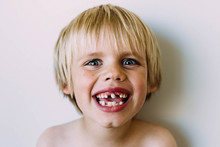 Portrait Of Smiling Shirtless Boy With Gap Toothed
